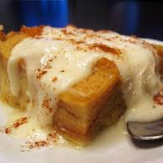 Bread Pudding with Hazelnut Liquor Sauce and Spiced Whipped Cream