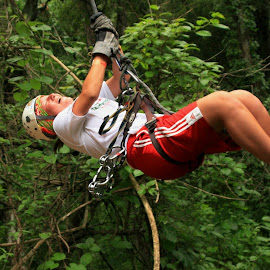 Kaitlyn Ziplining in Mexico by Debbie Salvesen - People Family ( child, enjoyment, wilderness, nature, mexico, family bonding, teenager, exhillaration, daughter, children, laughter, outside, zip lining,  )