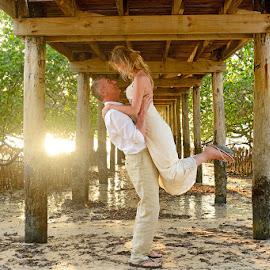 Sunset Lift by Andrew Morgan - Wedding Bride & Groom ( love, wedding, sunset, happiness, beach, bride, light, groom )