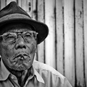 Old Man with Cigarette by Juang Rahmadillah - People Portraits of Men