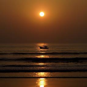 Sunset by Rajashri Joshi - Landscapes Beaches ( sunset, oranges, ocean, boat, sun,  )