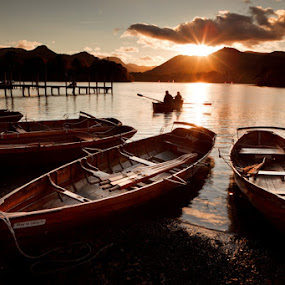 Boats on derwent water in the lake district by Pete Barnes - Landscapes Sunsets & Sunrises ( calm, mountain, jetty, landscape, keswick, photography, wakefield, love, england, pier, couple, activity, water, hill, uk, derwent, tourism, lake, leisure, still, boat, oar, dusk, row, lake district, sunburst, sunset, wave, active, sunrise, britain )