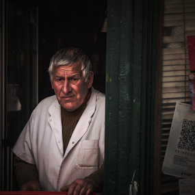 Time to open the store by Edi Libedinsky - People Portraits of Men ( expression, urban, store, street, dark, door, wait, entrance, man,  )