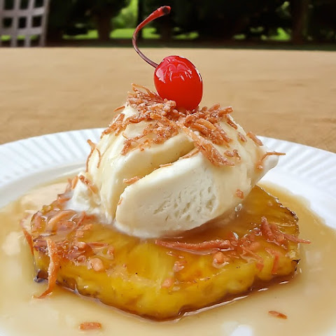 Grilled Pineapple with Ice Cream, Rum Sauce and Toasted Coconut