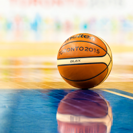Toronto PanAm 2015 Basket Ball on Floor by Roberto Machado Noa - Sports & Fitness Basketball ( basketball, games, panam, blue, 2015, toronto, panamerican, basket, court, pan am, yellow, pan american, shiny )