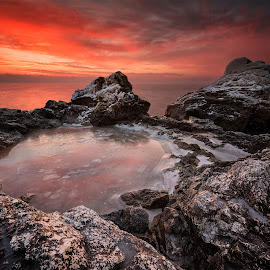Fire and ice by Evgeni Ivanov - Landscapes Sunsets & Sunrises ( smooth, tranquil scene, stone, rock, beauty, boulder, beach, coastline, landscape, sun, sky, nature, flowing water, idyllic, dark, long exposure, evening, water, wild, orange, reef, cliff, cloudscape, sea, seascape, sunlight, morning, dawn, sunset, background, moody sky, rocky coastline, cloud, sunrise )