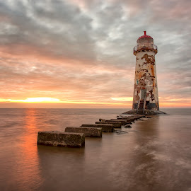 Leaning towards the light by Andy Young - Buildings & Architecture Other Exteriors ( talacre, north wales, uk, lighhouse, sunset, beach, seascape )