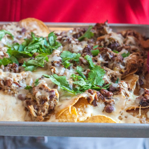 The Best Nachos Ever {pulled pork, green chilies and cheese nachos}