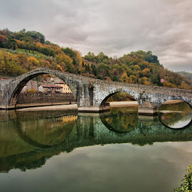 Ponte del diavolo (Borgo a Mozzano, Lucca, Italy) by Gianluca Presto - Buildings & Architecture Bridges & Suspended Structures ( water, reflection, water reflection, tuscany, arch, stone, architectural detail, circle, architecture, historic, circles, ancient, sky, nature, legend, arches, cloudy, historical, bridge, italy, river )
