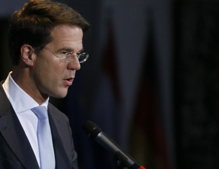 Dutch PM Rutte comes first in election but loses seats