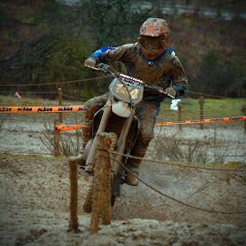 With His Last Ounce Of Strength by Marco Bertamé - Sports & Fitness Motorsports ( uphill, mud, rainy, motocross, strength, effort, clumps )