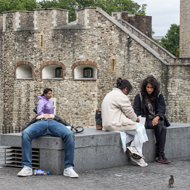 Not the first man to loose his head at the tower . by Vibeke Friis - City,  Street & Park  Street Scenes ( tower of london, man lying down, headless, optical illusion,  )