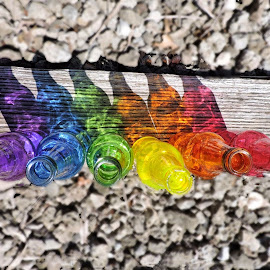 Lined up by Melissa Davis - Artistic Objects Glass ( train tracks, railroad tracks, bottle tracks, bottle art, colored bottles )