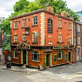 Ye Old Pub In England by T Sco - Buildings & Architecture Other Exteriors ( drinks, happy hour, building, oxford, cobblestone, road, uk, street, restaraunt, brick, europe, architecture, sidewalk, england, walkway, windows, people, manchester, drink, street sign, stone, orange, stones, window, pub )