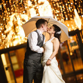 Bride and Groom Kissing under an Umbrella by Pete Barnes - Wedding Bride & Groom ( leeds, wedding photography, uk, umbrella, romantic, professional, photography, love, lights, lean, kiss, england, wedding, contemporary, dress, happy, photographer, informal, pete barnes, bride, groom, wedding photogapher, rain, britain )