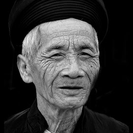 Wisdom by Kathryn Potempski - People Portraits of Men ( holiday, black and white, vietnam, travel, man, portrait, photography )