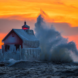 The Wave by David Behrens - Buildings & Architecture Other Exteriors ( afterglow, michigan, winter, lake michigan, ice, sunset, lighthouse, wave, storm )