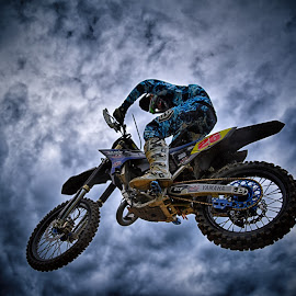Flying By by Marco Bertamé - Sports & Fitness Motorsports ( clouds, flying, yamaha, flying by, wheel, motocross, blue, speed, cloudy, round, number, 26, race, noise )