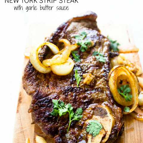 Pan Seared New York Strip Steak with Garlic Butter Sauce + Onions