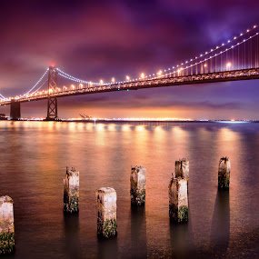 Bay Bridge by John Souza - Buildings & Architecture Bridges & Suspended Structures ( water, hdr, california, san fran, ocean, bay bridge, color, bay, dark, cloud, night, light, san francisco )