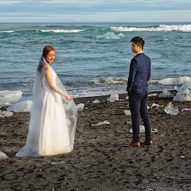 On the black sand beach by Michaela Firešová - Wedding Bride & Groom ( happy, couple, seaside, black sand, bride, groom )
