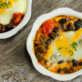 Breakfast eggs by Vrinda Mahesh - Food & Drink Plated Food ( breakfast eggs, baked eggs, eggs, beans, food, breakfast, bell peppers, cherry tomatoes, wooden background, plated food, overhead view )