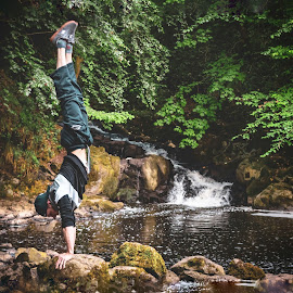 Water stand by Danny Charge - Sports & Fitness Other Sports ( rocks, outdoors, sports, athlete, waterfall, man, athletics, water, athletic )