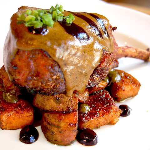 Double Cut Pork Chops with Tamarind Glaze, Green Mole Sauce and Caramelized Sweet Potatoes