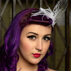 Tara at the lift by Dunstan Vavasour - People Portraits of Women ( studio, purple hair, victory roll, model, lift, fascinator, pin-up, cage, modelling, cleavage, standing )