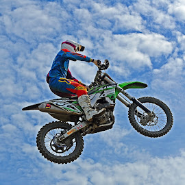 Flying Away ! by Marco Bertamé - Sports & Fitness Motorsports ( clouds, flying, sky, motocross, blue, air, high, alone, race, jump, competition )