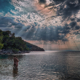 Driven out of paradise by Michal Fokt - Uncategorized All Uncategorized ( clouds, sea, people, rays )
