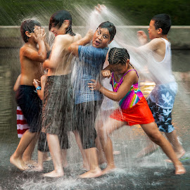 Water Play by Jon Kinney - City,  Street & Park  Street Scenes ( fountain, children )