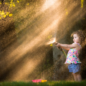 Rays of Water by Mike DeMicco - Babies & Children Child Portraits ( water, babies, spray, innocent, beautiful, little, fun, cute, woods, pretty, rays, portrait, child, love, hose, sweet, girl, sprinkler, happy, outdoor, curls, wonder, summer, adorable, light, outside )