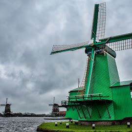 Green windmill in Netherland , Zaanse Schans Amsterdam by Gianluca Presto - Buildings & Architecture Public & Historical ( mill, mills, europe, ancient, sky, green, holland, cloudy, travel, windmills, netherlands, windmill )