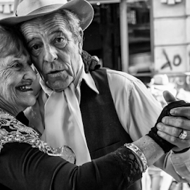 To Dance Tango in the Street  by Samy St Clair - People Couples ( expression, dancing, affection, san telmo, black and white, candid, buenos aires, people, portrait, street photography, argentina, love, tango, couple )