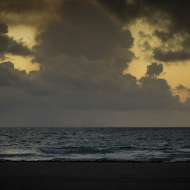 The kiss by Mark Thompson - People Couples ( clouds, kiss, silhouette, sea, beach, people, lifegaurd hut )