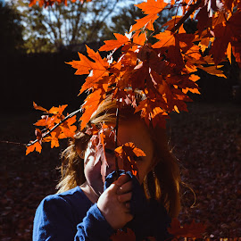 See me? by Kayla House - Babies & Children Child Portraits ( fall leaves, girl, fall, trees, leaves, peek a boo, outside, portrait, red head )