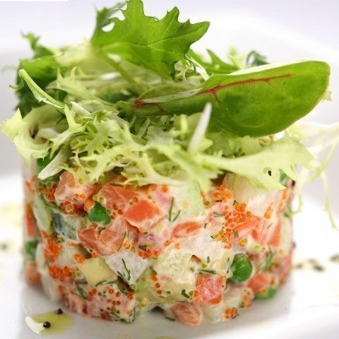 Salad Olivier with salmon and cucumber
