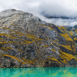 Glacier Melt by Garry Dosa - Nature Up Close Rock & Stone ( rock, mountain, green, outdoors, reflections, aqua marine, lichen, clouds, autumn, water, landscape, stone )