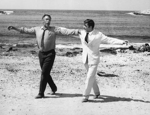 "Anthony Quinn's famous ""Zorba the Greek"" dance scene has since been recreated by scores of musicians and dancers across the world.  (Scene from ""Zorba the Greek"" (1964), Michael Cacoyannis, Director/Producer)"