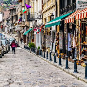 Pedestrian street with souvenir shops by Opreanu Roberto Sorin - City,  Street & Park  Markets & Shops ( shop, famous, old, europe, store, street, house, architecture, travel, people, historic, city, ancient, turnovo, flowers, classic, bulgaria, building, vintage, veliko, tourism, cart, ox, landmark, tourist, european, background, town, local, bulgarian, medieval, tarnovo, walk, balkans,  )