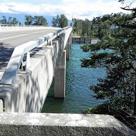 Bridge over the Harrison River, BC by Kim Jackson - Transportation Roads ( clouds, water, sky, trees, bridge, concrete, river )