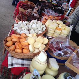Meat and Cheese on Display in Portugal by Dawn Simpson - Food & Drink Meats & Cheeses ( markets, meat, street stall, tourism, cheese, travel, delicious, portugal )