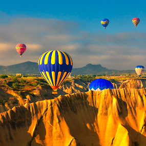 Floating over Cappadocia, Turkey by Rafael Uy - Landscapes Travel ( landmark, hot air balloon, pwc82, lunar landscapes, goreme, travel, turkey, balloon, cappadocia, air, transport )