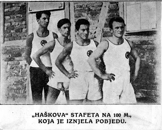 Matz, at the back, stands with three other track and field athletes.