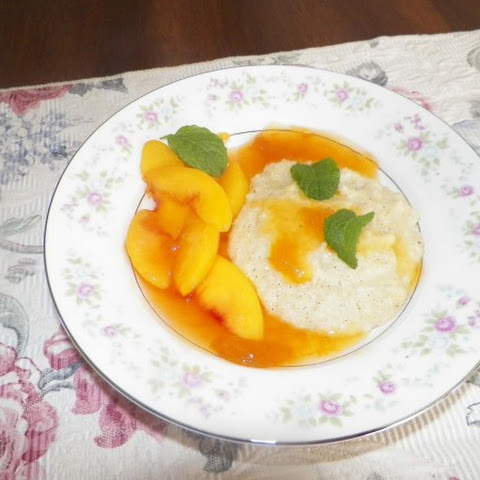 Baked Grits Pudding with Peach Sauce