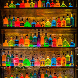 Colorful Glass Bottles by Carl Albro - Artistic Objects Glass ( store, colors, shelves, bottles )