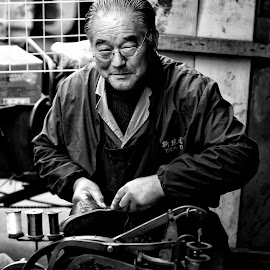 The Cobbler by Freddy Ng - People Street & Candids ( portraiture, black and white, wet market, man, shanghai, street photography, china )