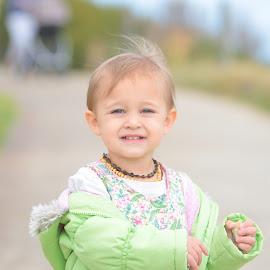 blue eyes by Stefanie Hawkins - Babies & Children Child Portraits ( jacket, blue, green, flowers, eyes )