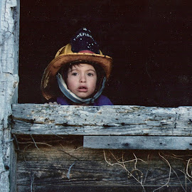Lonely little fireman by Cathy Henson - Babies & Children Child Portraits ( ignored, barn, sad, fireman, lonely,  )